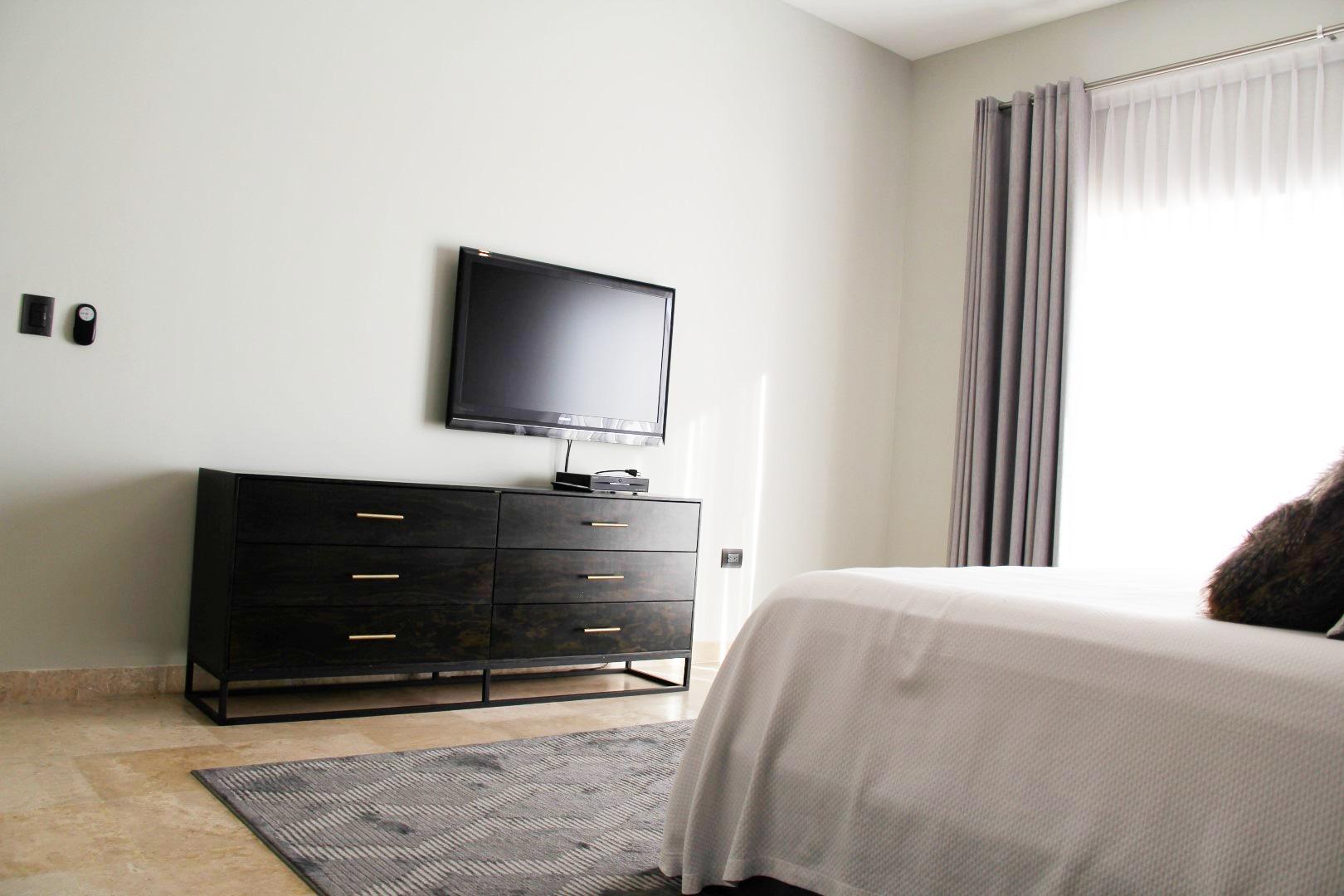 TV in master bedroom.