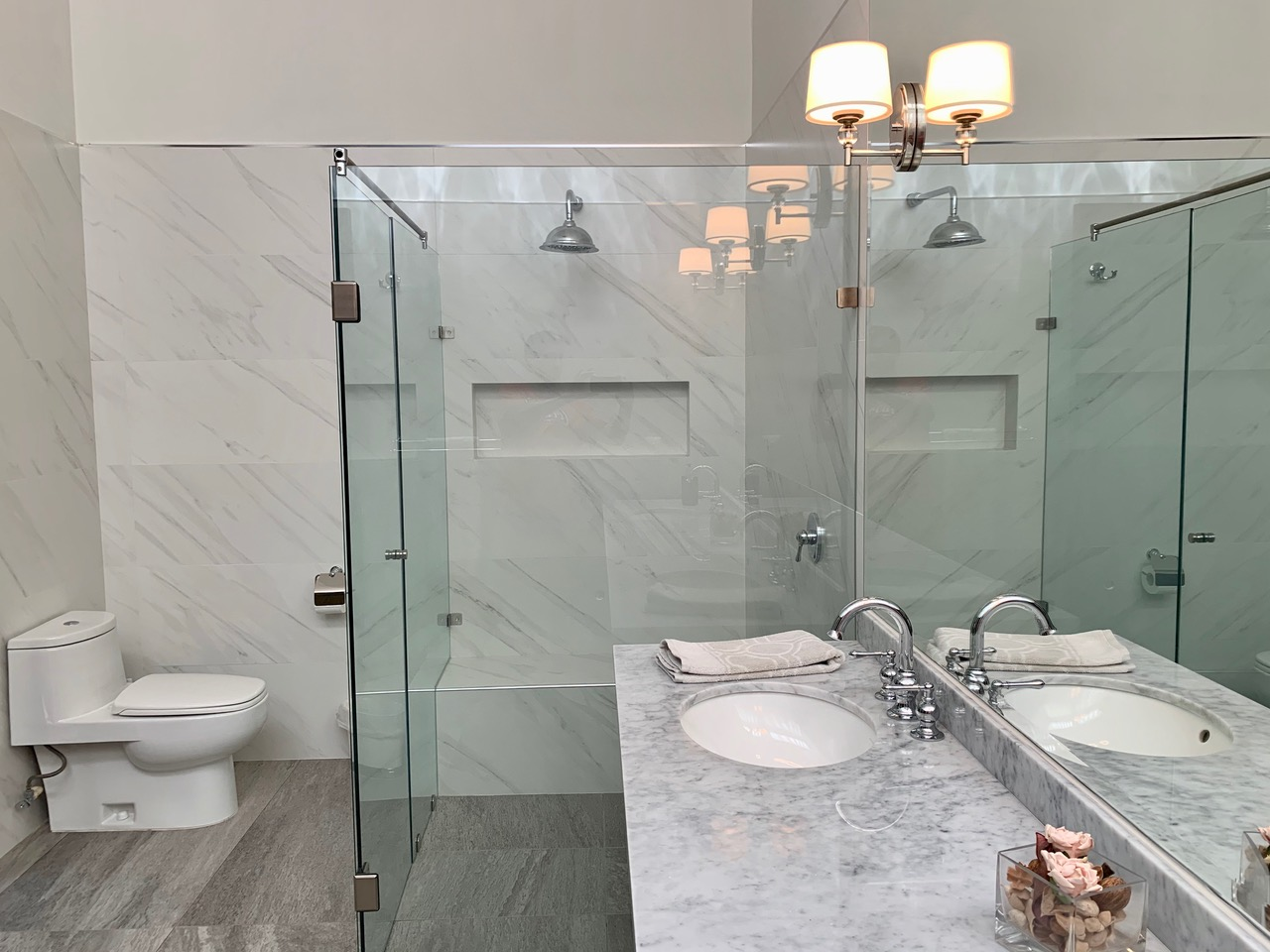 Bright master bathroom with large shower.