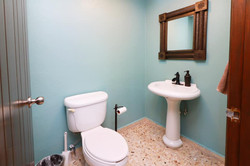 Half bathroom off of kitchen.