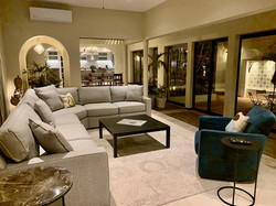 Living room and patio at night.