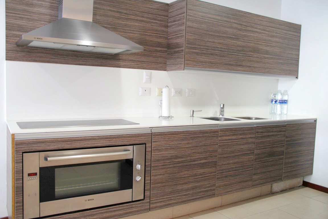 Modern galley-style kitchen.