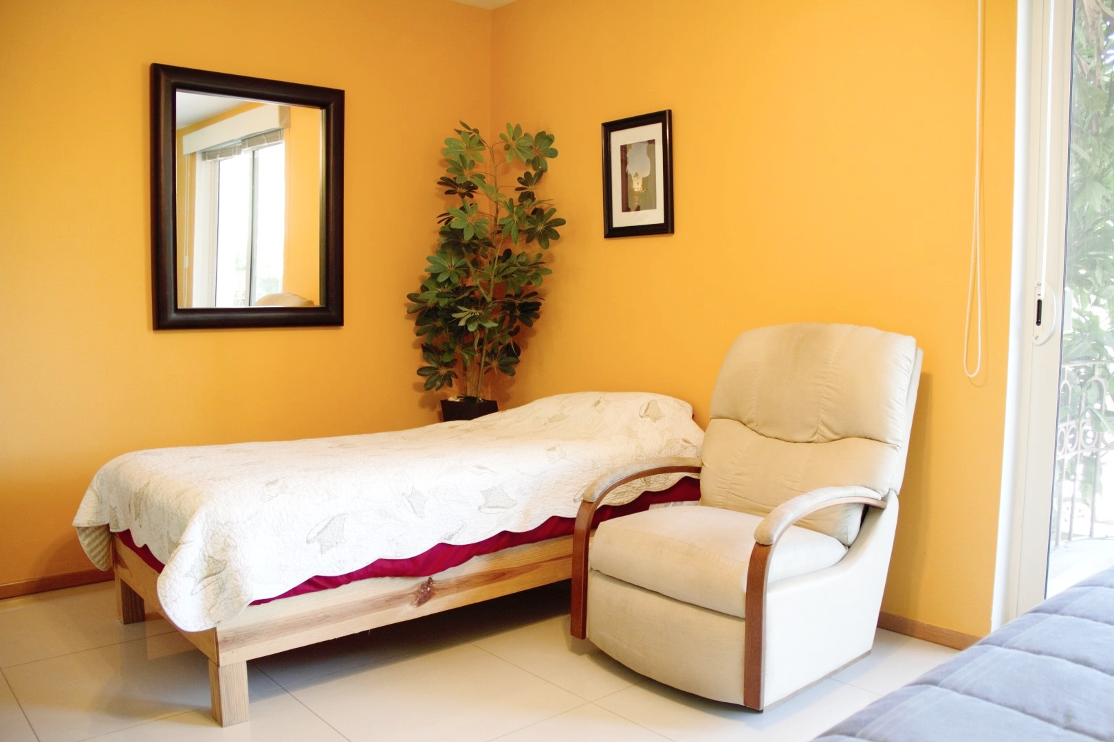 Twin bed and seating in second bedroom.