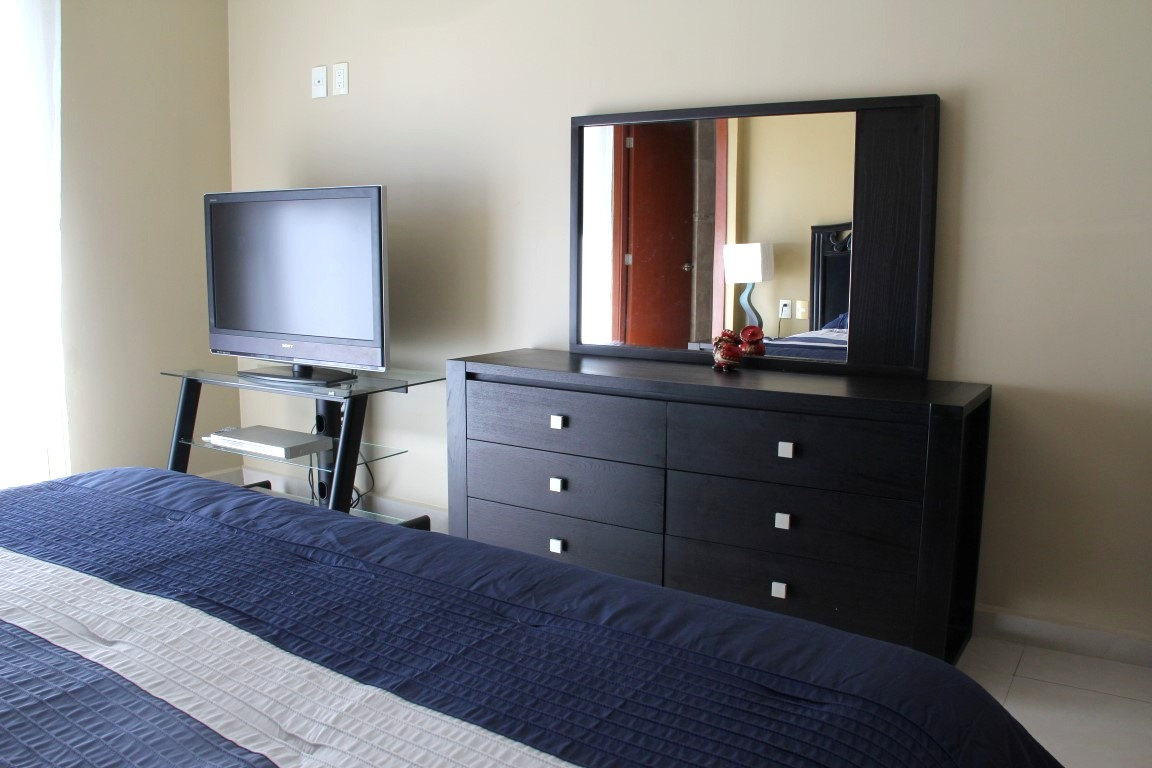TV and dresser in master bedroom.