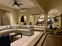 Living room and dining room in the evening with curtains drawn.
