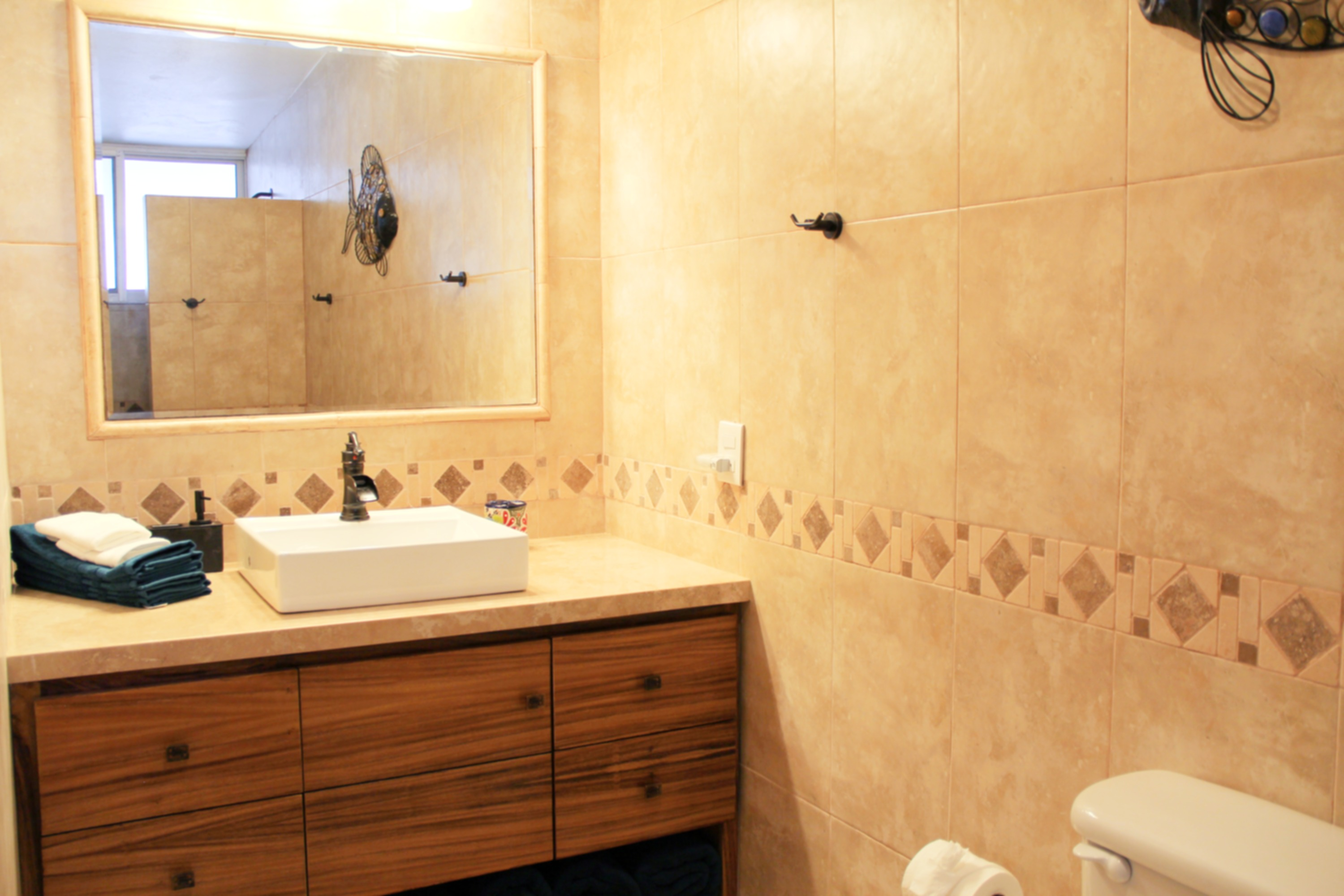 Remodelled ensuite with shower in first bedroom.