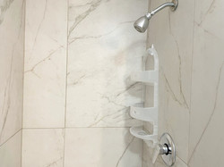 Updated tiled showers with glass doors.