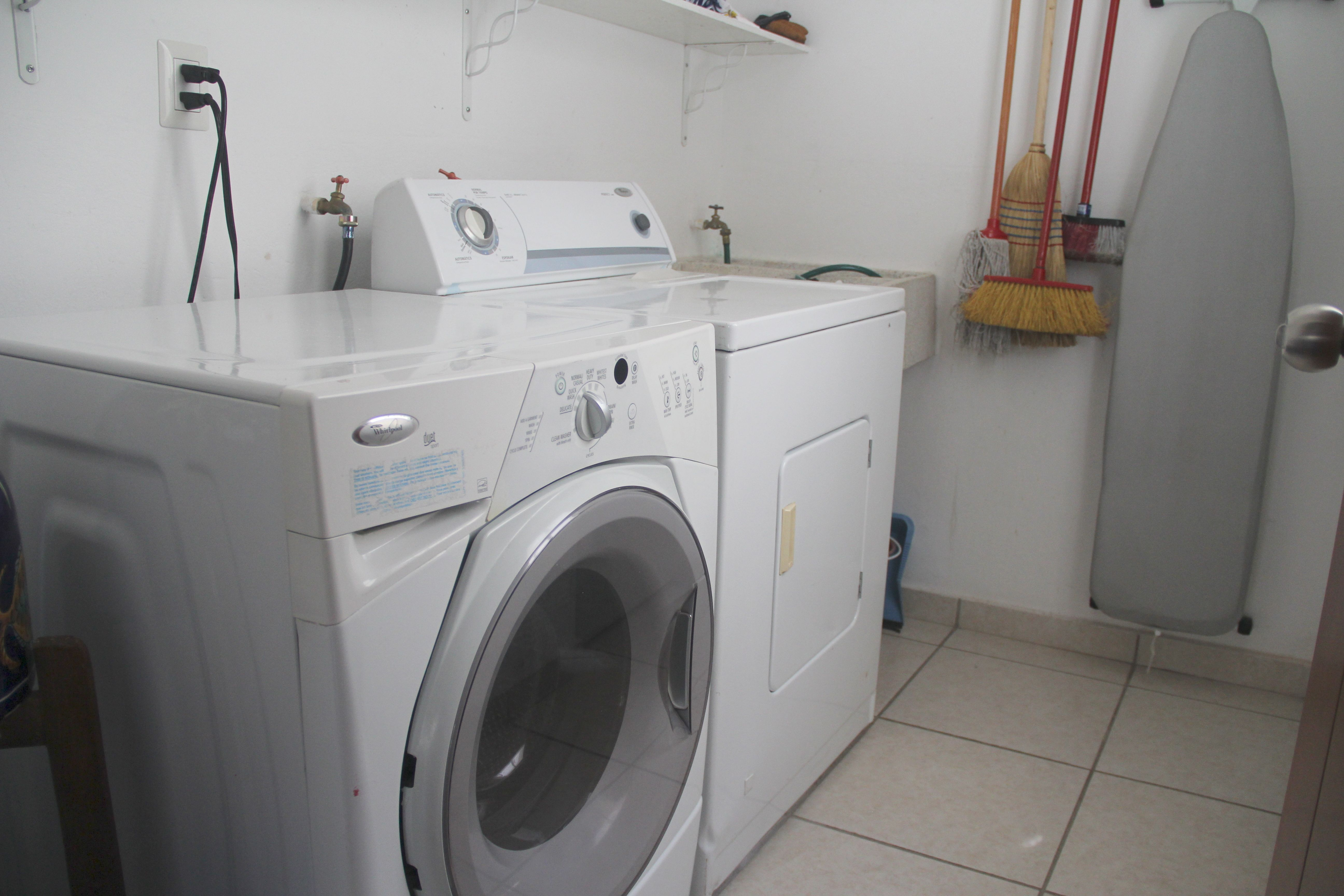 Service room with washer and dryer