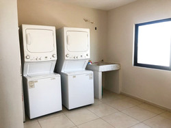 Shared laundry area on roof-top.