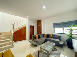 Open floor plan with stairs to the second level.
