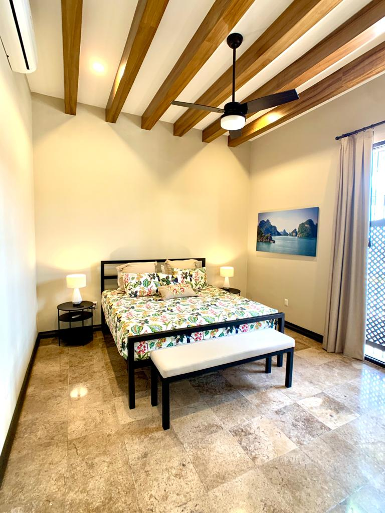 Third bedroom with custom art and furniture.