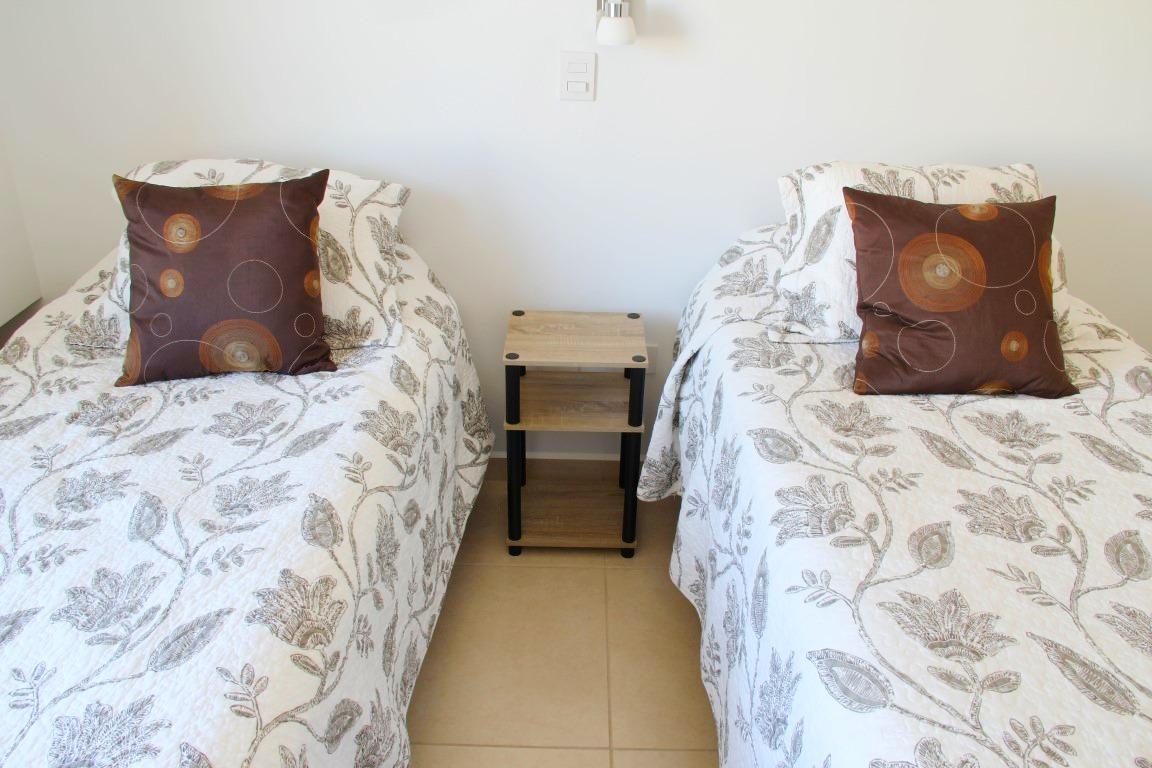 2 twin beds in third bedroom.