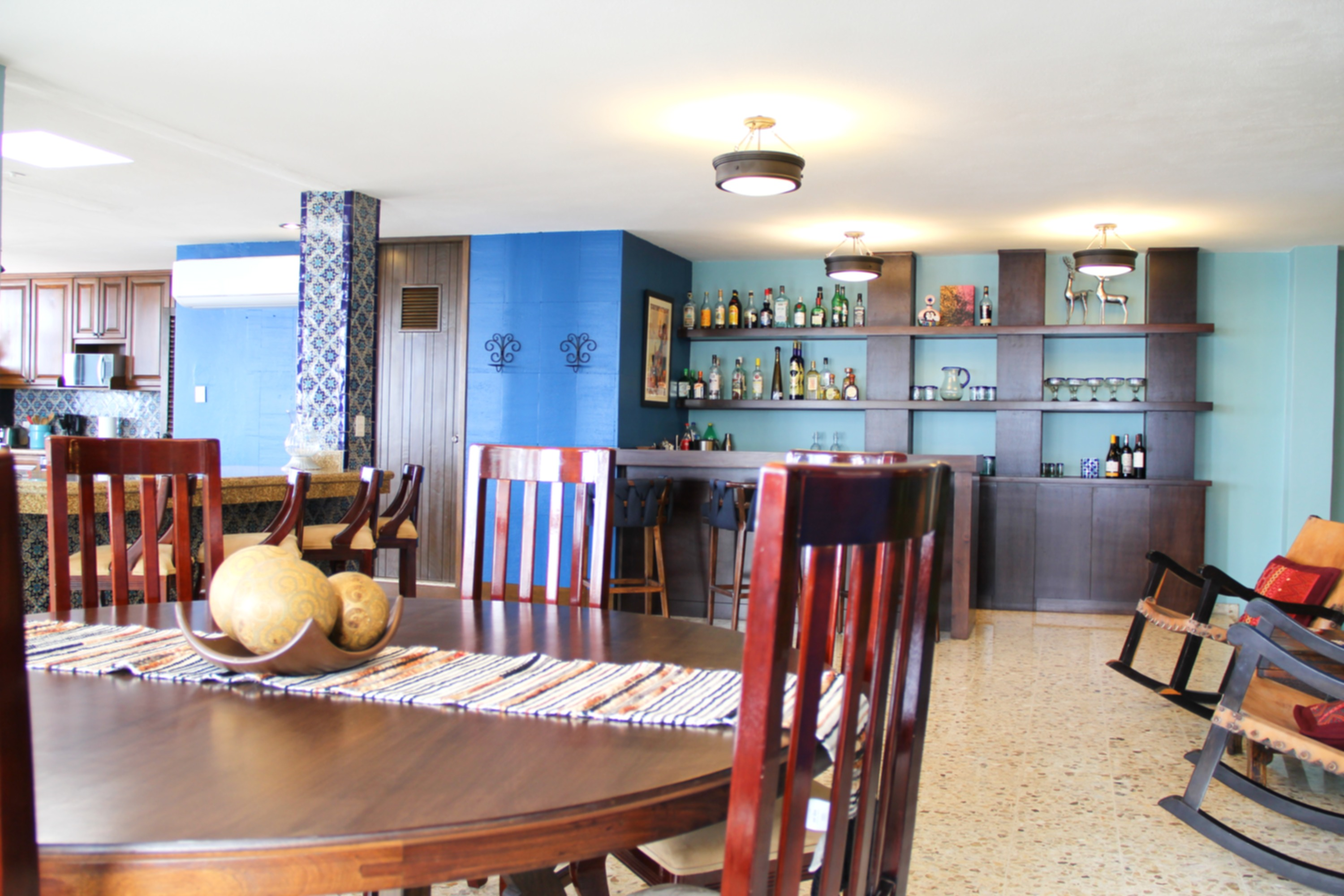 Open dining area to bar and kitchen.