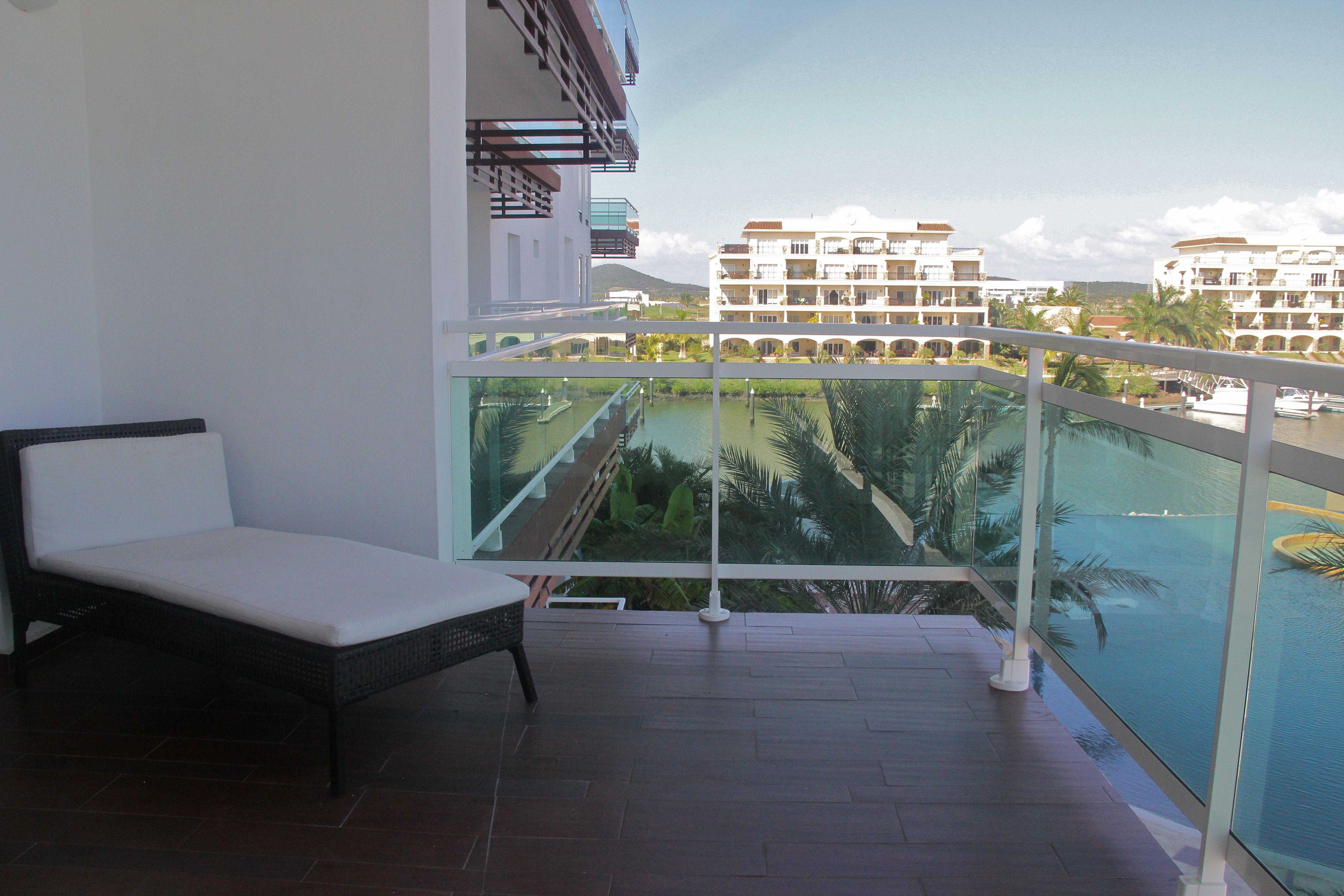 Terrace overlooking pool & marina.