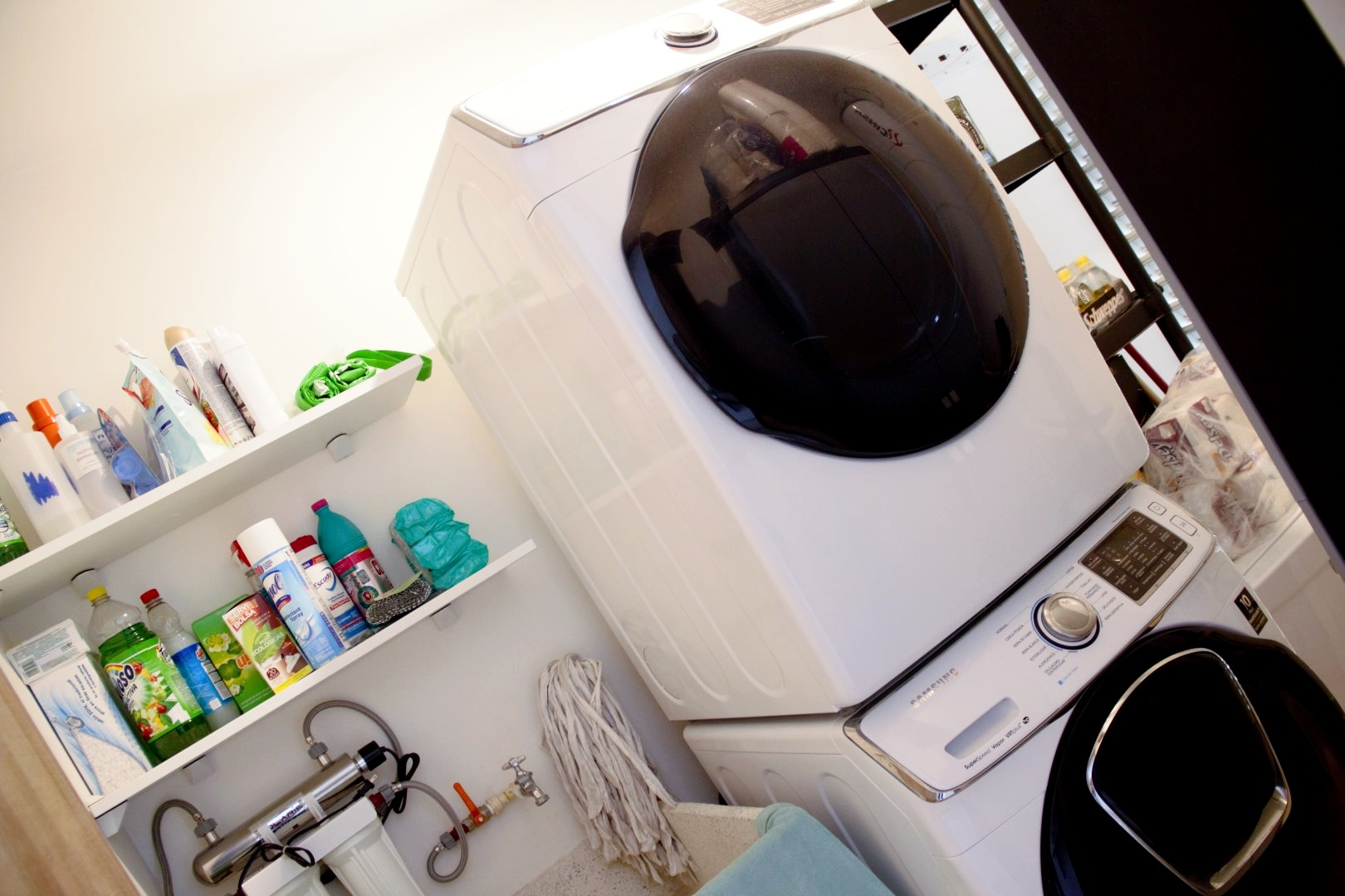 Cleaning and laundry area, with full-size appliances.