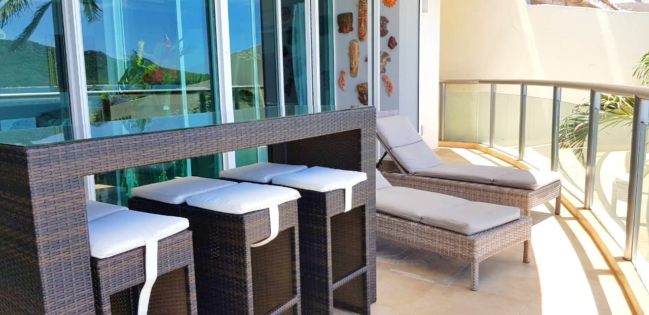 Outdoor seating on covered terrace.