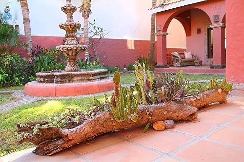 Hacienda style garden with fountain.