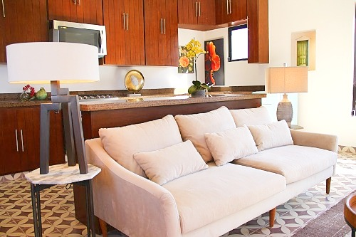 Apartment living room open to kitchen.