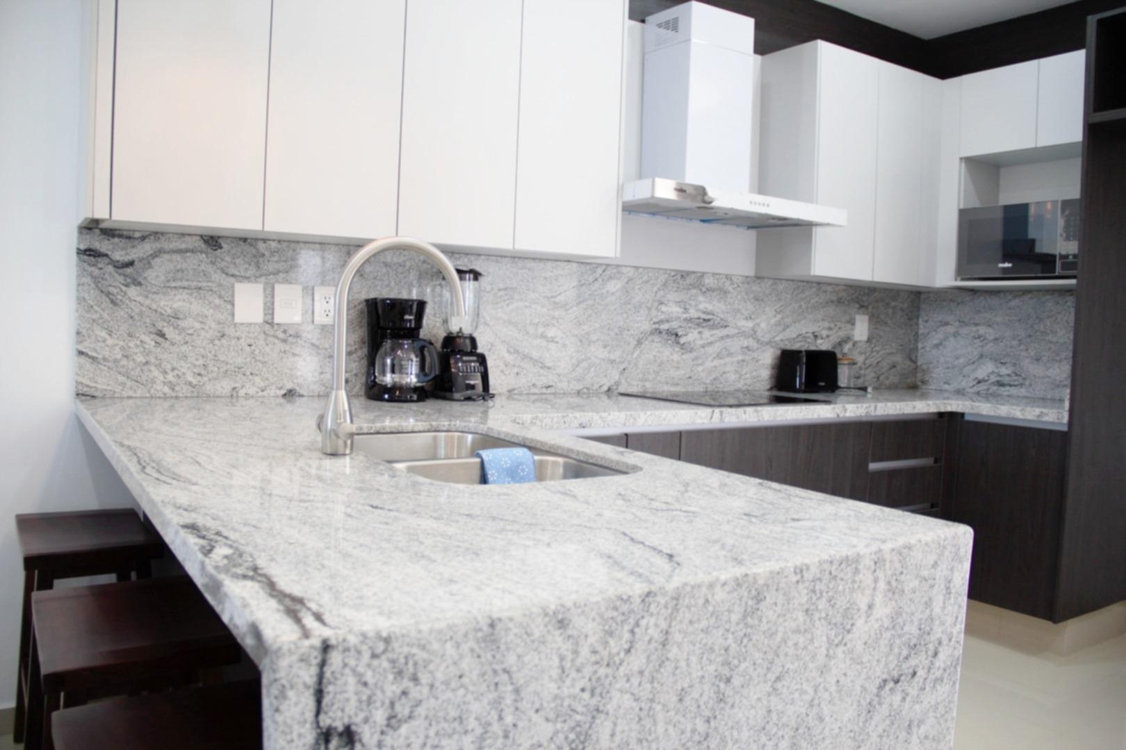 Large modern kitchen with breakfast bar.