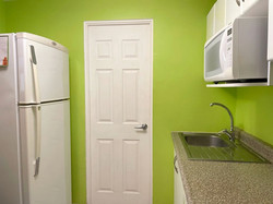 Kitchen with access to laundry area.