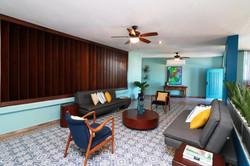 Sleeper sofas and modern furnishings in living room.