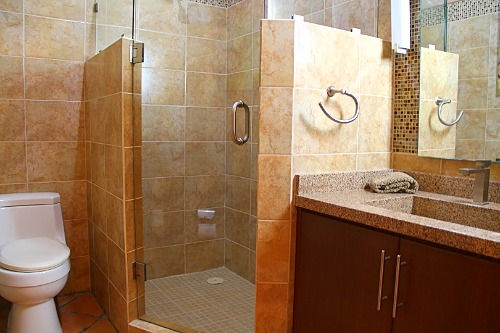 Shared bathroom with shower on main level.