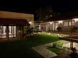 Private yard with custom lighting for evening.