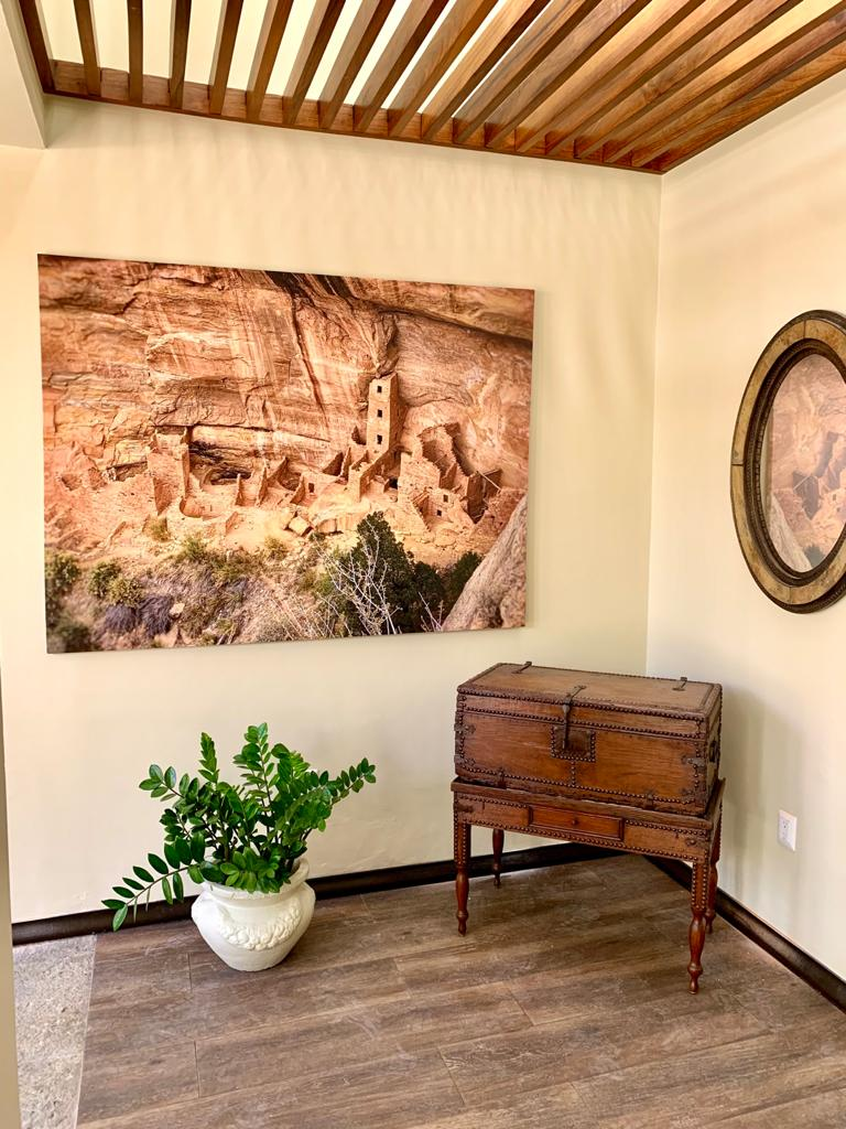 Main foyer with custom art and historic pieces.