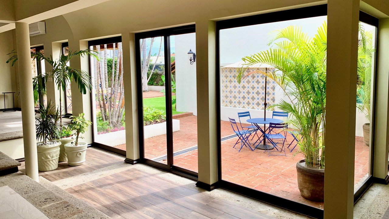 Beautiful expansive windows in living areas, with views of the private yard and patios.