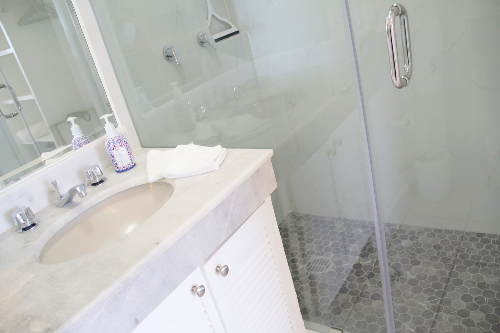 Beautiful, large walk-in tiled shower.