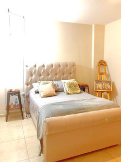 Double bed with nightstands.