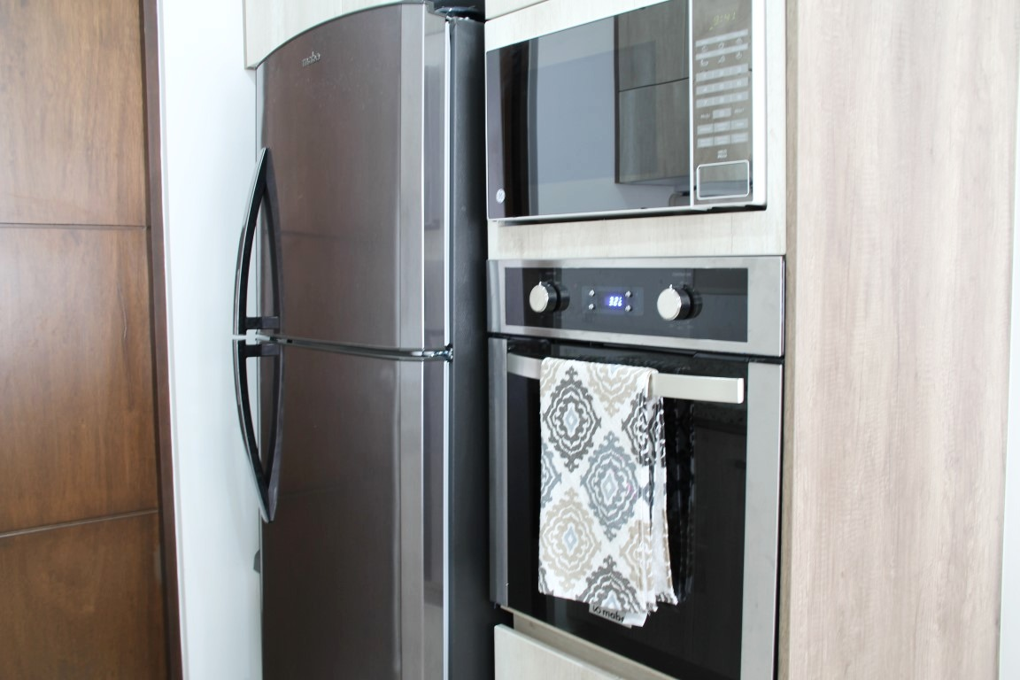 Full size refrigerator and oven.