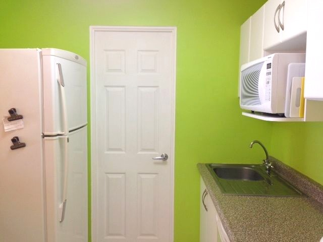 Door to laundry room with stacked washer/dryer.