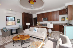 Apartment with kitchen, living room and dining area.