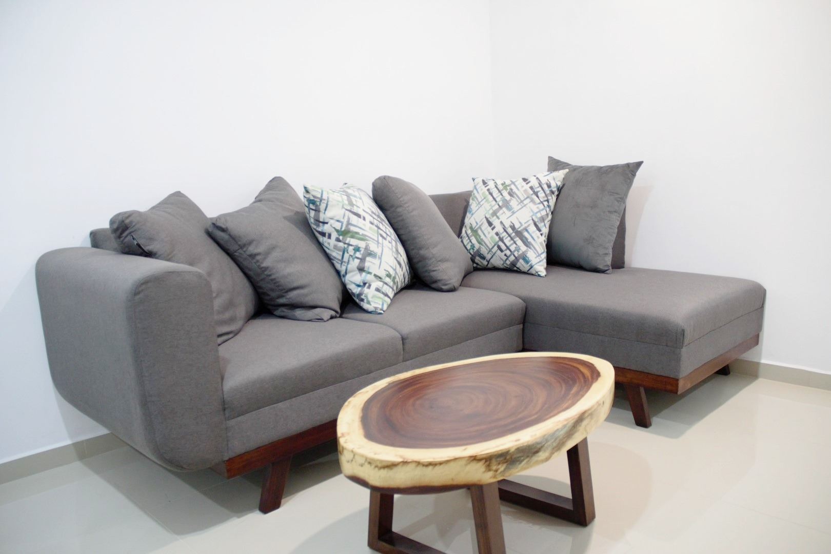 Sectional sofa with natural wood coffee table.