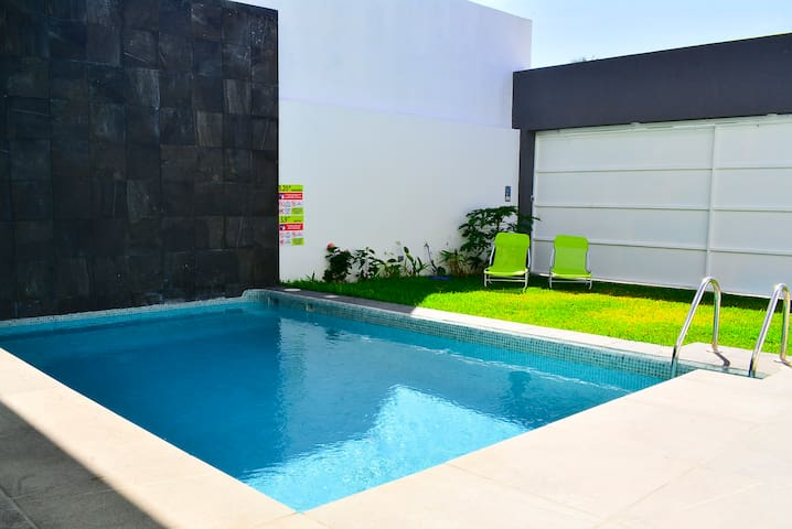 Large private pool and yard.