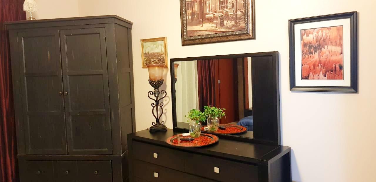 Master bedroom with hidden TV.