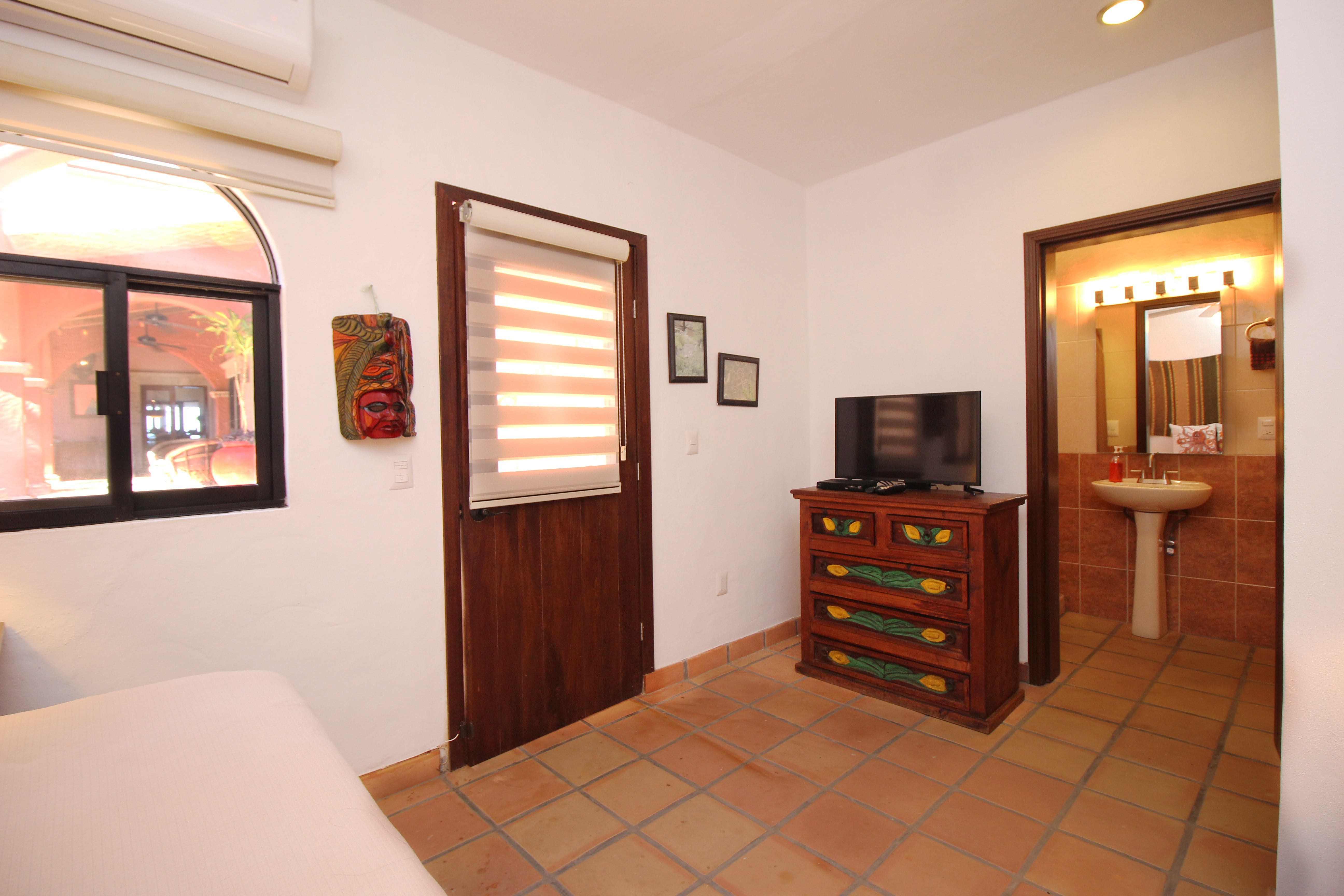 Bedroom with single bed and ensuite with shower.
