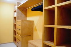 Walk-in closet in master bedroom.