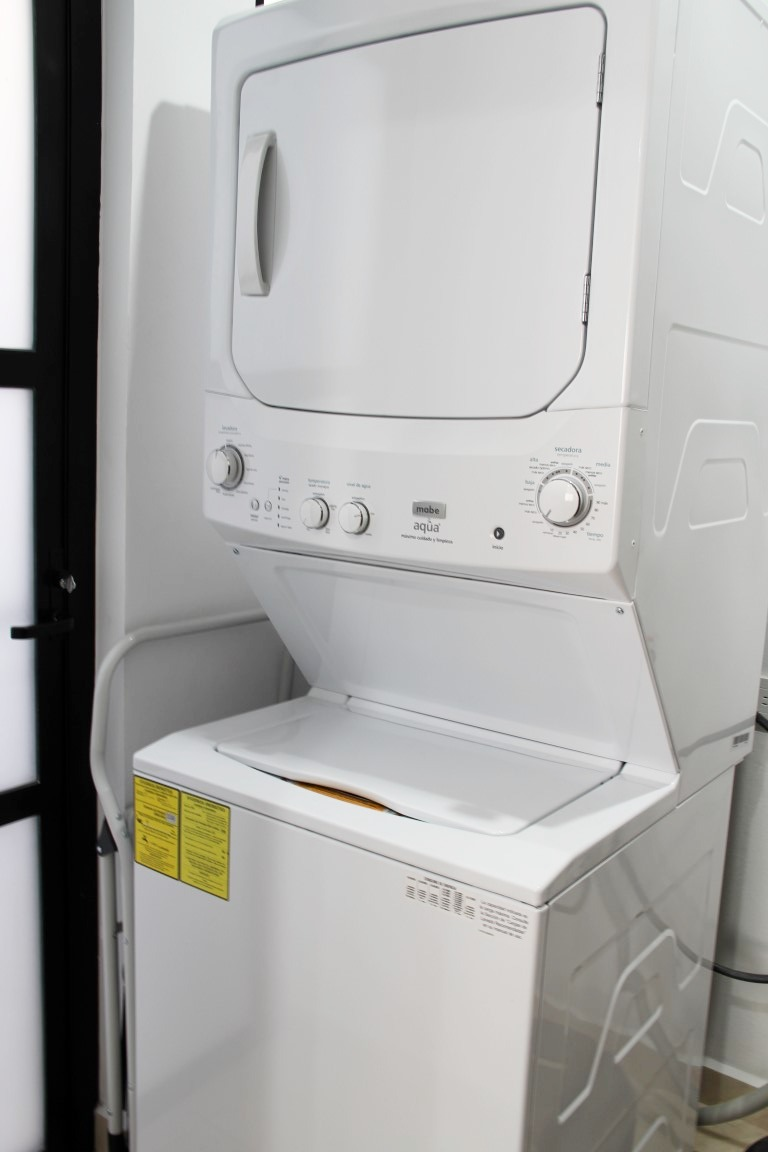 Washer and dryer located off kitchen