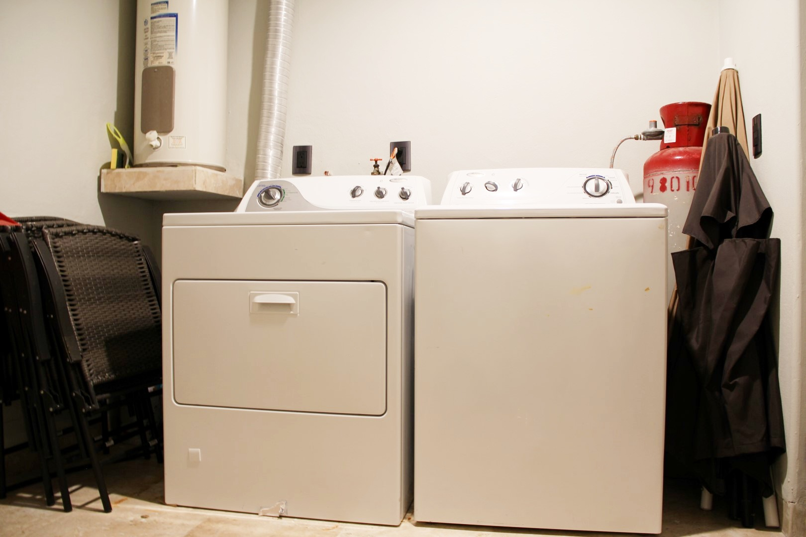 Large service room with full size washer and dryer.