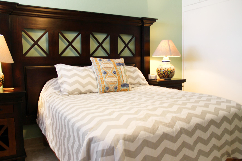 Queen bed in first bedroom.