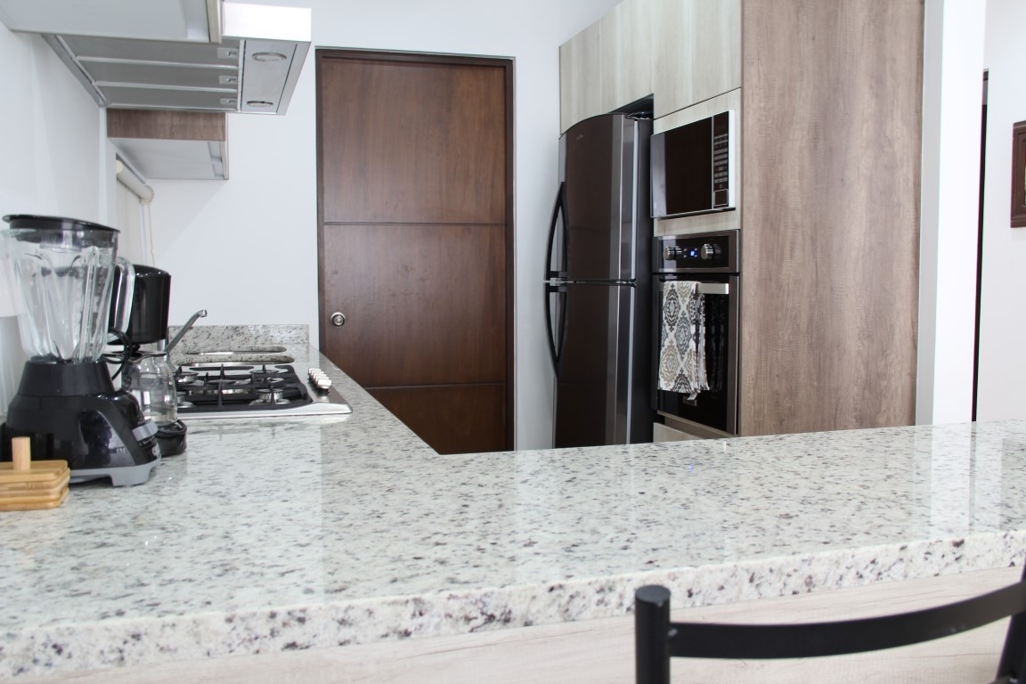 Equipped kitchen with granite.