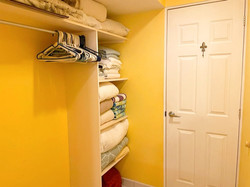 Walk-through closet in master bedroom.
