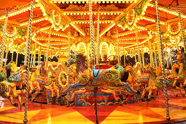 colorful carousel with lights at night.j