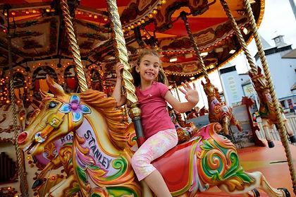 Little girl riding Carousel horse