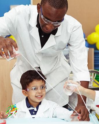 Cute science kid with JOhn.jpg
