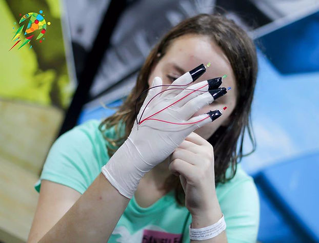 A girl loving her new eletronic, bionic arm during electronics class