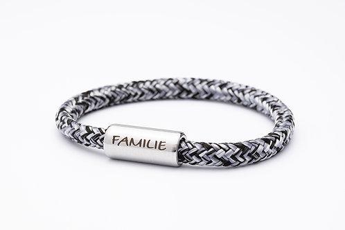 Armband schwarz/ weiß meliert, mit Tomanika Familie