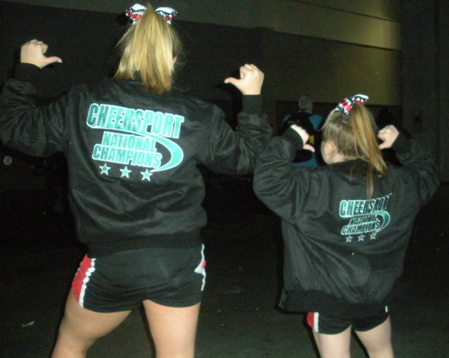 Becky (left) received her CHEERSPORT jacket in her last year as an Allstar; Rachle in her first.