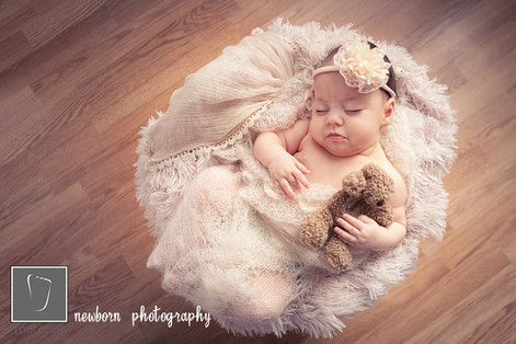 Newborn sleeping, snugged and cosy. Art image and decoration.